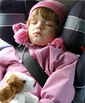 Sleeping kid in a car seat